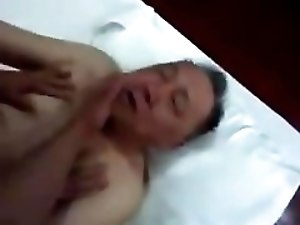 Asian grandpa used by younger