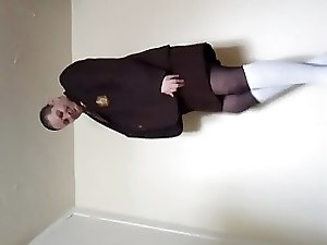 Transvestite schoolgirl in tights and socks