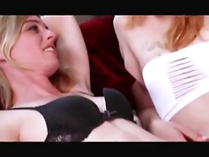 Two beautiful trannies in lingerie fucking